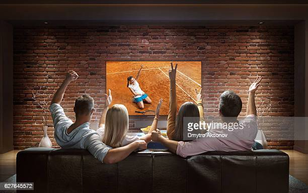 Couples watching Tennis game at home