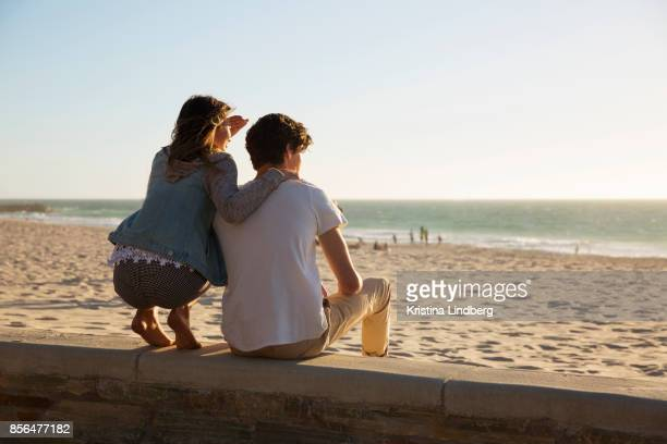 coupple by the beach at sun set - perth australia stock photos and pictures