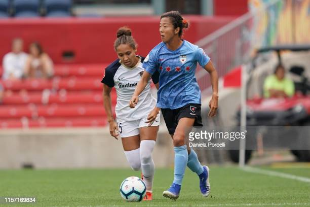 Courage defender Jaelene Hinkle defends against Chicago Red Stars forward Yuki Nagasato during the NWLS soccer game between Chicago Red Stars and...
