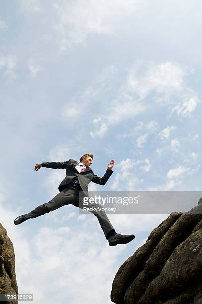 Courageous Businessman Jumping Over Valley