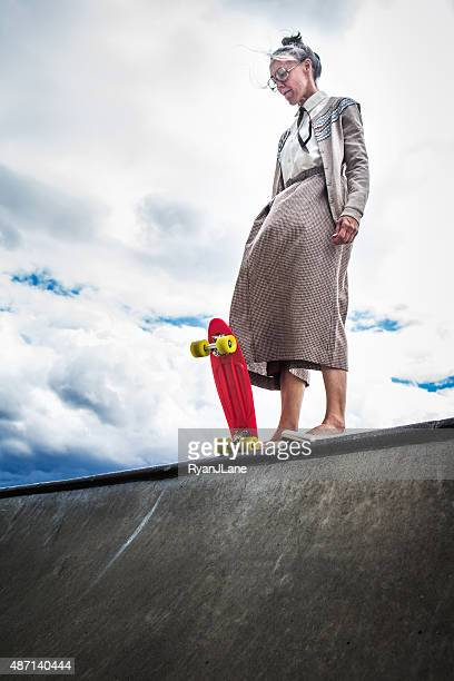 courageous grandma at skatepark - moed stockfoto's en -beelden