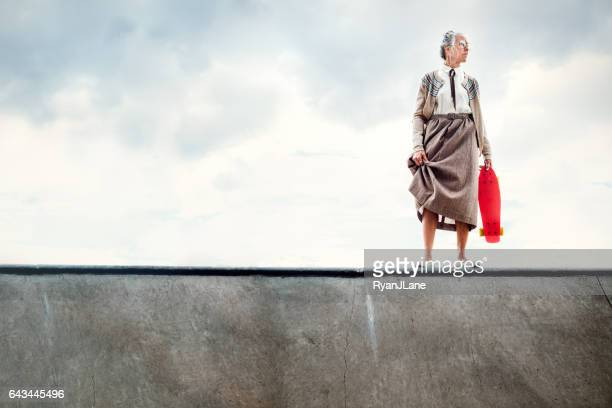 courageous grandma skateboarding - practical joke stock photos and pictures