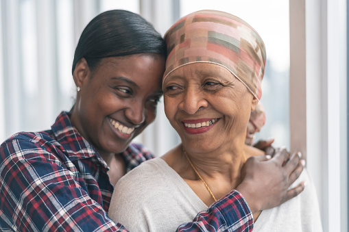 Courageous woman with cancer spends precious time with adult daughter 1141776184