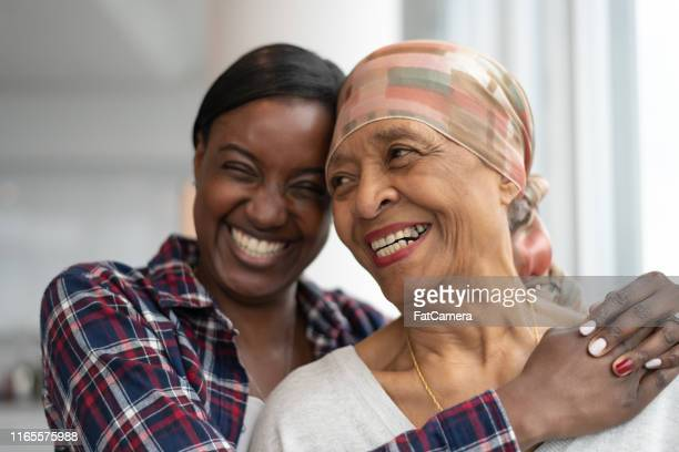 courageous woman with cancer spends precious time with adult daughter - immune system stock pictures, royalty-free photos & images