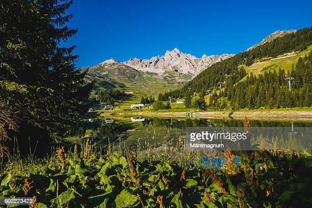 courchevel 1850, the lake near the golf field - trois vallees stock pictures, royalty-free photos & images