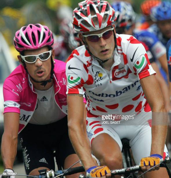 German Andreas Kloden rides alongside with Danish Michael Rasmussen during the eleventh stage of the 92nd Tour de France cycling race between...