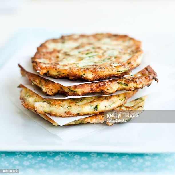 courgette fritters with feta cheese - fritter stock photos and pictures