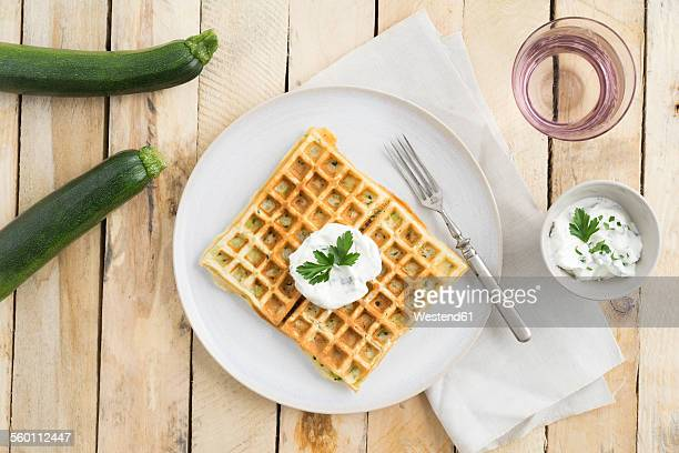 Courgette waffles with herbed curd cheese