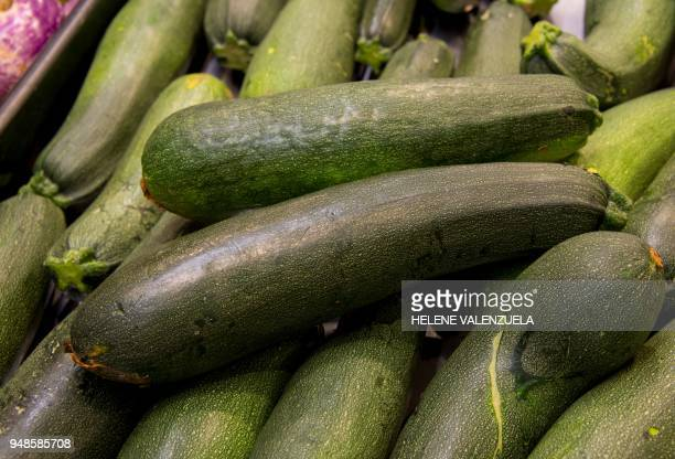 Courgettes are pictured at the fruit and vegetable department of an 'O Marche' supermarket in SaintFrancois on the French overseas territory of...