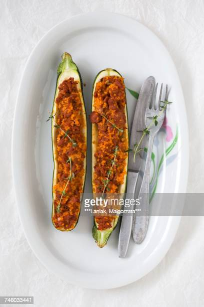 Courgettes filled with minced meat, millet and tomato sauce