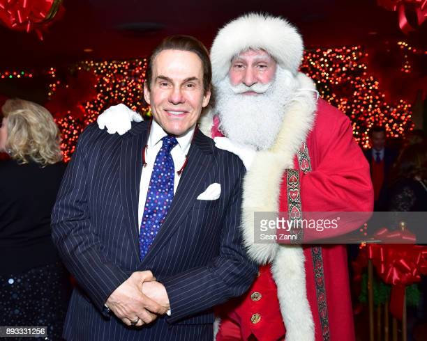 R Couri Hay and Santa Claus attend A Christmas Cheer Holiday Party 2017 Hosted by George Farias and Anne and Jay McInerney at The Doubles Club on...