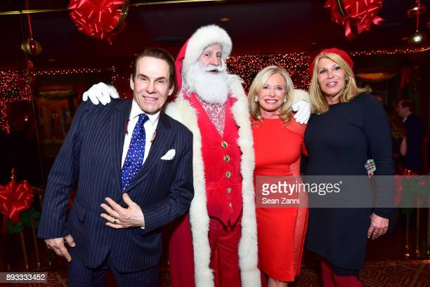 R Couri Hay Santa Claus Sharon Bush and Dottie Herman attend A Christmas Cheer Holiday Party 2017 Hosted by George Farias and Anne and Jay McInerney...