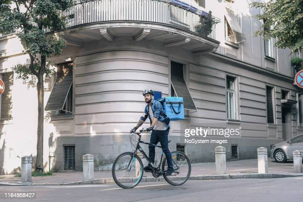 courier delivering packages - delivery person stock pictures, royalty-free photos & images