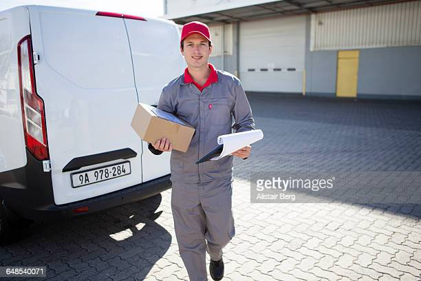 Courier delivering parcel
