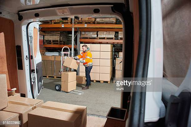 courier filling his van - loading dock stock pictures, royalty-free photos & images