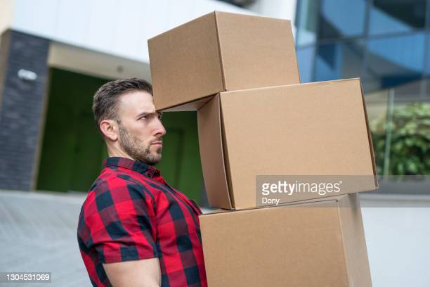 courier has a lot of boxes to delivery. even sending a lot of parcels is no problem. - luggage hold stock pictures, royalty-free photos & images
