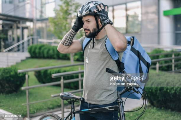 courier on a cargo bike delivering packages - bicycle messenger stock pictures, royalty-free photos & images