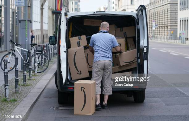 Courier unloads Amazon packages during a delivery on June 18, 2020 in Berlin, Germany. Amazon has expanded rapidly in Germany and now has at least 13...
