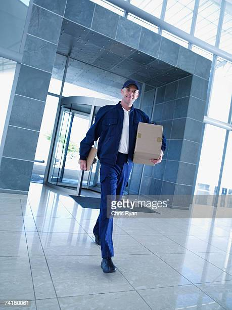 Courier with clipboard and cardboard box