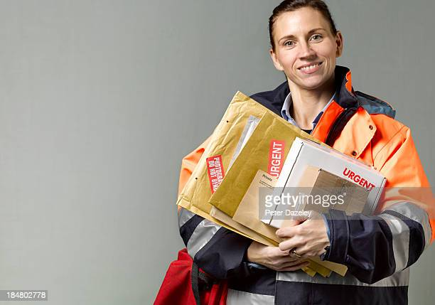 courier/postwoman with copy space - mail stock pictures, royalty-free photos & images