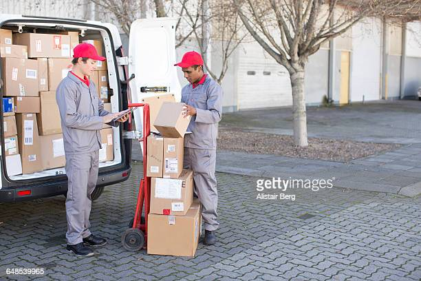 Couriers delivering parcels and boxes
