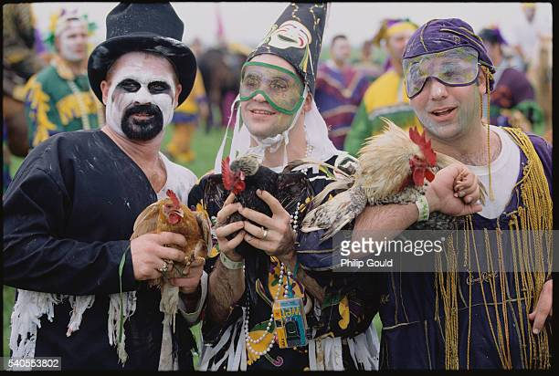 courir de mardi gras participants holding chickens - gras stock pictures, royalty-free photos & images