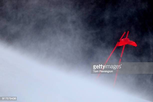 A course gate is blown by the wind during the Men's Alpine Combined Downhill on day four of the PyeongChang 2018 Winter Olympic Games at Jeongseon...