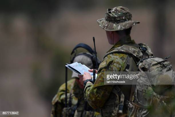 JTAC course member checks his map before live ordance is dropped from a RAAF F/A18 Hornet as part of Exercise Black Dagger on October 5 2017 in...