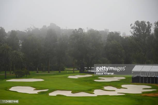 Course scenic view as rain falls and fog rolls in on the 10th hole during the first round of the Genesis Open at Riviera Country Club on February 14,...