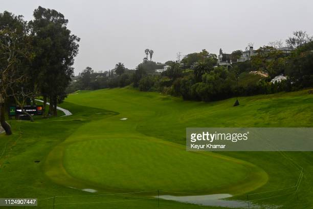 Course scenic view as rain falls and fog rolls in on the 18th hole during the first round of the Genesis Open at Riviera Country Club on February 14,...