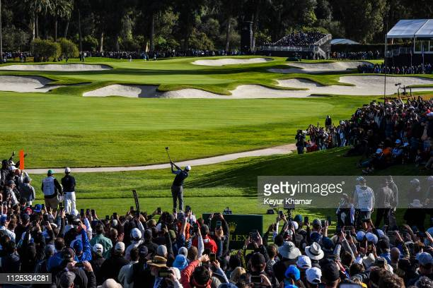 Course scenic view as Tiger Woods tees off on the 10th hole and fans watch during the third of the Genesis Open at Riviera Country Club on February...