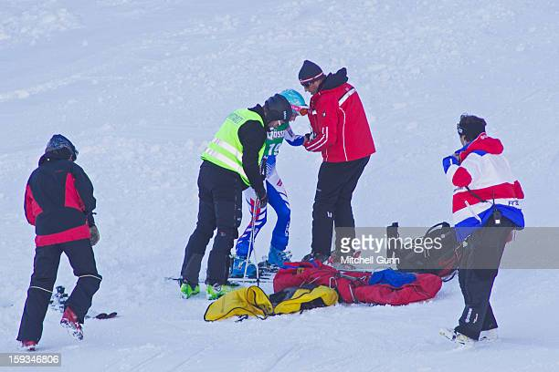 A course worker and first aid team assist Marie MarchandArvier of France after she crashed on the Kandahar course while competing in the Audi FIS...