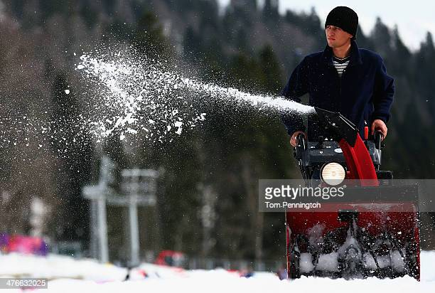 Course worker uses a snow blower while working on the course at the Laura Cross-Country Ski & Biathlon Center prior to the 2014 Paralympic Winter...