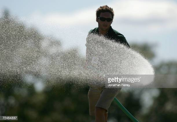 A course worker waters the seventh green during the final round of the 104th US Open at Shinnecock Hills Golf Club on June 20 2004 in Southampton New...