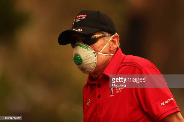 A course worker wears a face mask due to the smokey conditions during day one of the 2019 Australian Golf Open at The Australian Golf Club on...