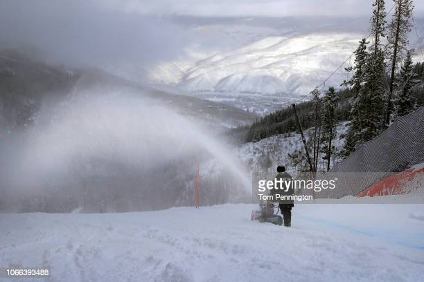 Course workers clear snow from the Birds of Prey racecourse after the Audi FIS Alpine Ski World Cup Men's Downhill Training was canceled due to...