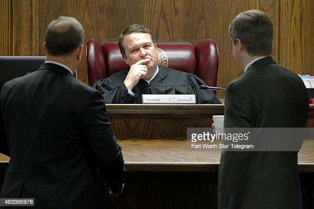 Court appointed defense attorney J Warren St John meets at the bench with State District Judge Jason Cashon and Erath County District Attorney Alan...