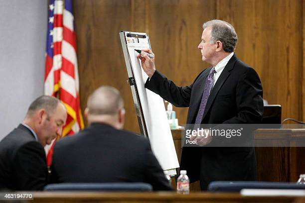 Court appointed defense attorney Tim Moore writes a timeline during the opening day of the capital murder trial of former Marine Cpl Eddie Ray Routh...