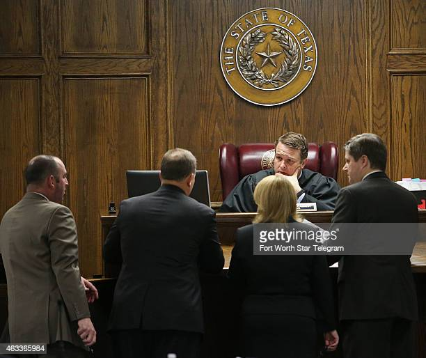 Court appointed defense attorneys R Shay Isham and J Warren St John meet at the bench with State District Judge Jason Cashon and Texas Attorney...