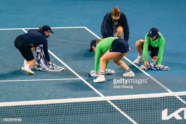 Court attendants a ball kids wipe bird droppings off the court surface in the Men's Singles Semifinals match between Daniil Medvedev of Russia and...