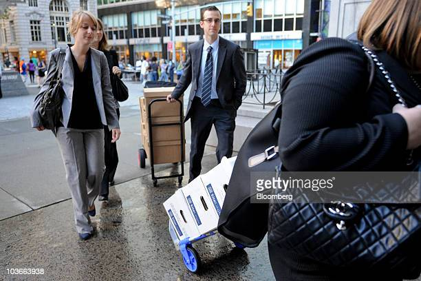 Court documents are wheeled into US Bankruptcy Court for a trial to determine whether Barclays Plc should pay as much as $11 billion for realizing an...