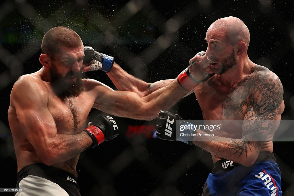 Court McGee and Ben Saunders exchange punches during the UFC Fight Night event at the at Talking Stick Resort Arena on January 15, 2017 in Phoenix, Arizona.