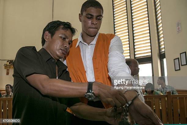 Court officer opens the handcuffs of Tommy Schaefer of the United States as he stands on trial ahead of his verdict on April 21, 2015 in Denpasar,...
