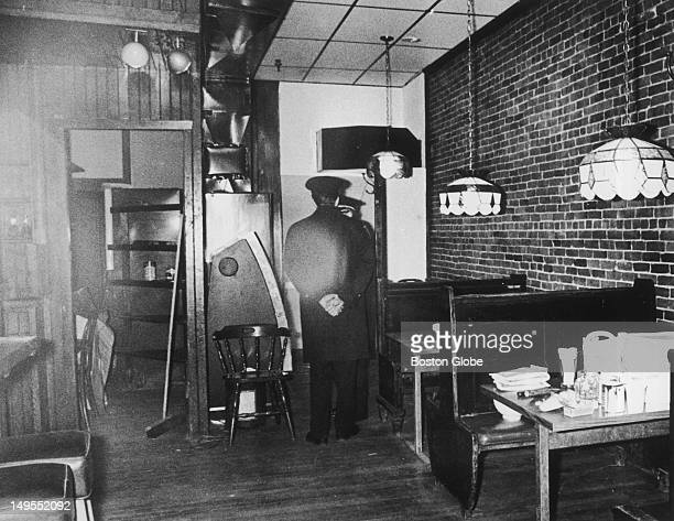 A court officer stands guard in the main upstairs room of the Blackfriars Pub while the jury tours the downstairs where the five men were slain The...