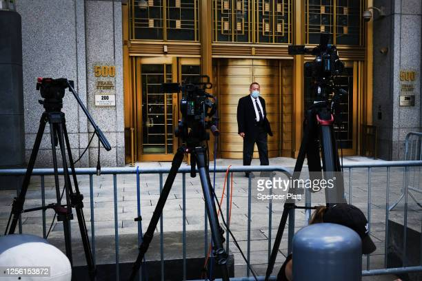 A court officer stands outside a Manhattan courthouse where media have gathered for the arraignment hearing of Ghislaine Maxwell on July 14 2020 in...