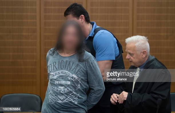 A court orderly takes the handcuffs off of the accused Hell's Angel's hands as he enters the security hall of the District Court before the start of...