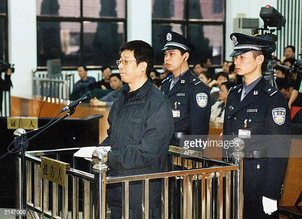 Court police stand behind Wang Tianyi a Wenzhou district police officer appealing his case against corruption charges in a Zhenjiang province...
