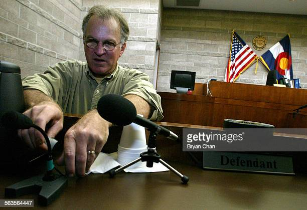Court TV camera operator Dennis Lynch sets up microphones on Tuesday at the table where Laker star Kobe Bryant will hear the sexual assault case...