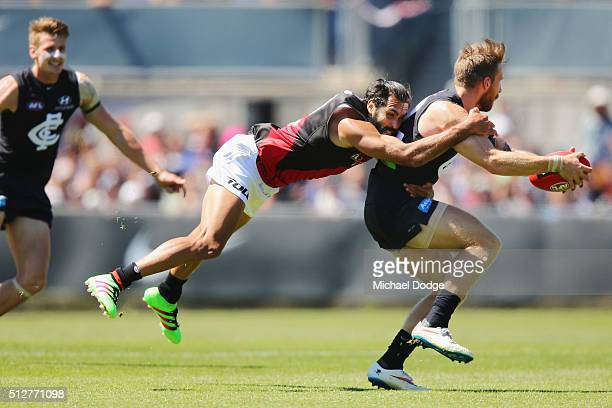 Courtenay Dempsey of the Bombers tackles Zach Tuohy of the Blues during the 2016 AFL NAB Challenge match between Carlton and Essendon at Ikon Park on...