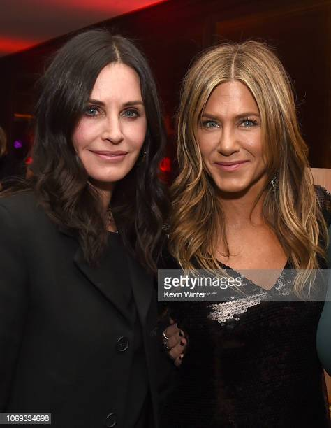 Courteney Cox and Jennifer Aniston pose at the after party for the premiere of Netflix's Dumplin' at Sunset Tower on December 6 2018 in Los Angeles...